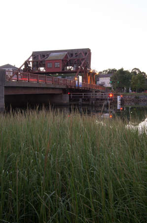 A bascule bridge in Boston Ma, with river grasses.