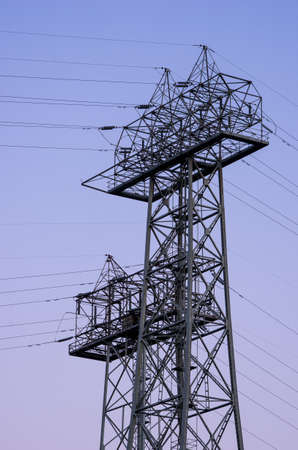 High tension power tower at sunset Foto de archivo
