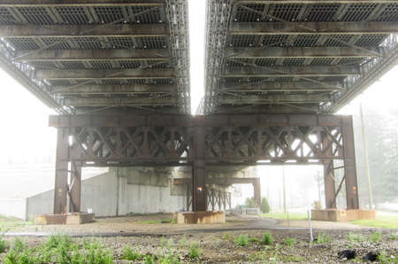 The underside of the Fore River Bridge in Weymouth Ma is shrowded in fog.