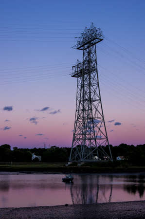 tension: High tension power tower at sunset Stock Photo