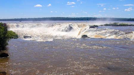 brown muddy water of amazon river in iguazu falls in brazil