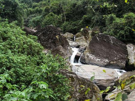 Ramboda waterfall in Sri Lanka. Water flowing surrounded by rocks