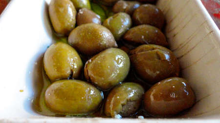 Mixed olives on a white plate Stock Photo