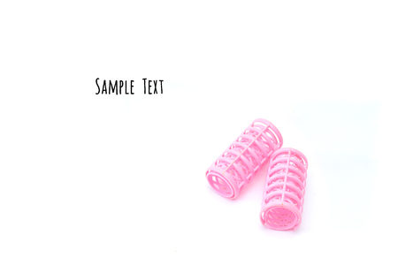 hair curlers: Pink hair curlers isolated on white background