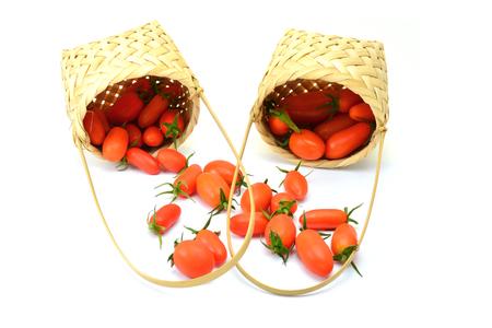 nat: Tomato in basket wood on white background