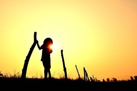 Silhouette children farmer at sunrise