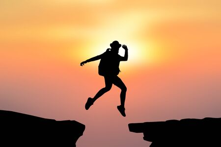 leap: Silhouette women jumping on top mountain