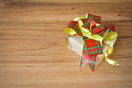 chritmas: Little beautiful gift box on wood background , vintage tone and soft focus, concept of chritmas and new year day