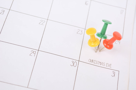 background calendar: Close up pin on a calendar background , Christmas and new year concept,soft focus
