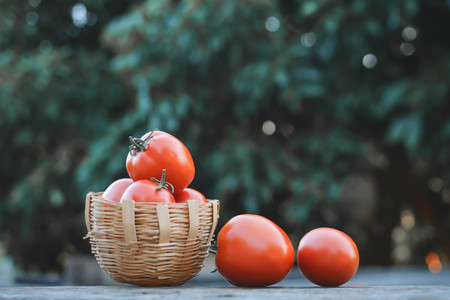 Tomato in basket on wood from Thailand selective and soft focus
