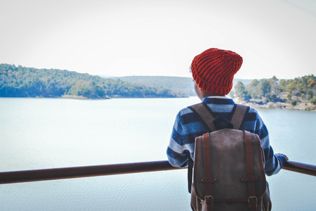 niño con mochila: Happy Asian boy backpack in nature background, Relax time on holiday concept travel, color of vintage tone and soft focus Foto de archivo