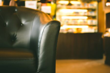 Close up leather sofa in the coffee shop background