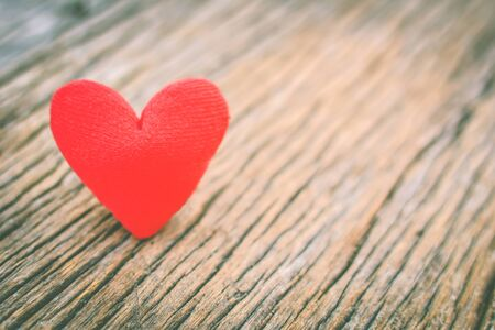 Valentine day red heart on old wood ,Hipster tone and soft focus. Stock Photo