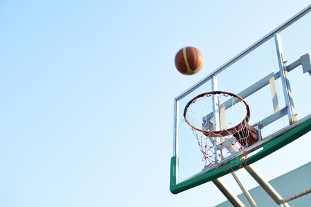 backboard: Close up basketball on hoop in the  arena Stock Photo