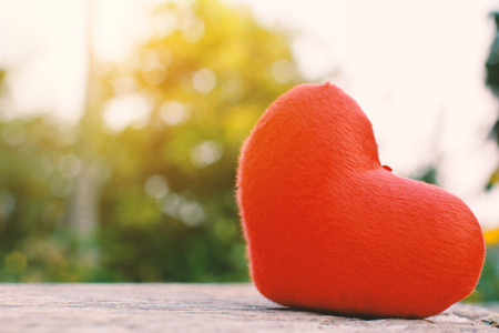 Red heart shape on old wood and bokeh background