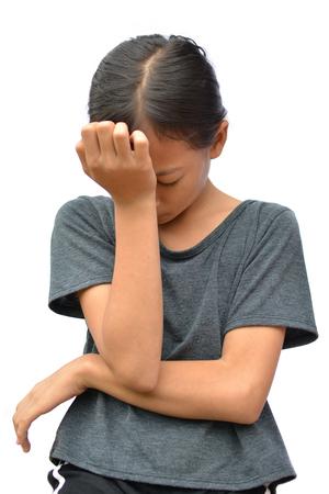 Sad little Asian girl on white background