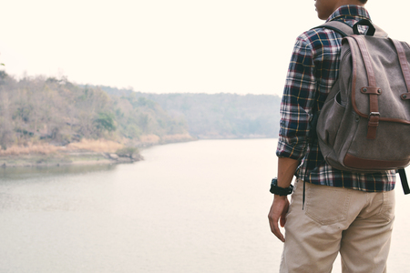 Happy Asian hipster man backpack in nature background, Relax time on holiday concept travel , color of vintage tone and soft focus Stock Photo