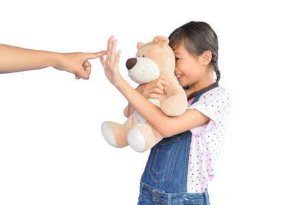 scolded: Portrait of little Asian girl scolded on white background
