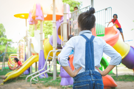Asian girl playing in playground happy on holiday selective and soft focus Reklamní fotografie