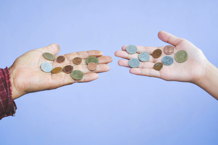 Old hands holding coins selective and soft focus vintage tone