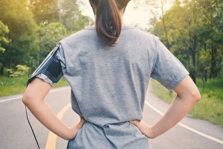 Women running on the road for health, color of vintage tone selective and soft focus Stock Photo