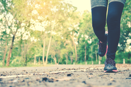 Women running on the road for health, color of hipster tone selective and soft focus Stock Photo
