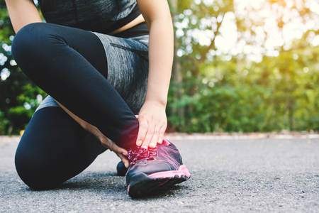 Women accident during running on the road , color of vintage tone selective and soft focus Stock Photo