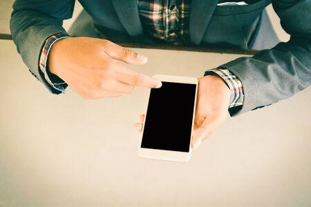 Businessman using smart phone color of vintage tone Stock Photo