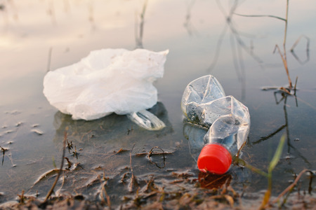 garbage in lake water pollution Stock Photo