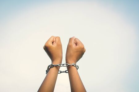 Close up hands in chains concept lack of freedom Stock Photo