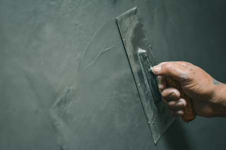 Hand of man working plastering on wall Stock Photo