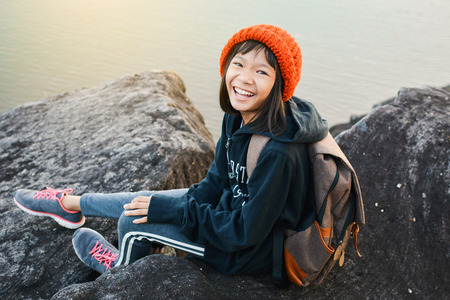 Asian girl backpack in nature winter season, Relax time on holiday concept travel,selective and soft focus,tone of hipster style