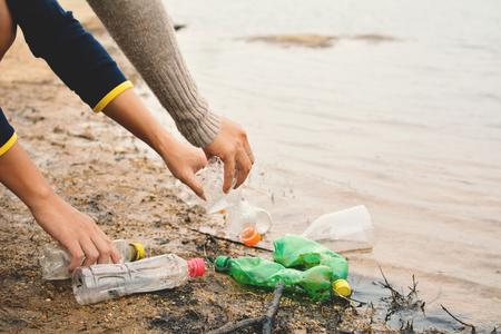 Hand of people picking up empty of bottle plastic ,volunteer concept Stock Photo