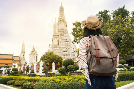 Asian women backpacker  travel Wat Arun temple, Relax time on vacation hipster lifestyle