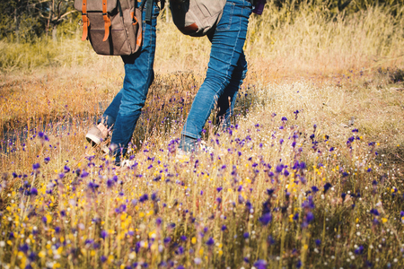 Feet of children walking in beautiful flower filed, Relax time on holiday