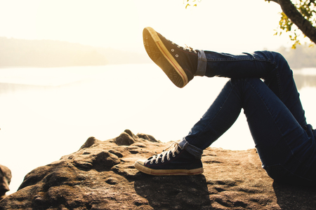 Feet of boy sleeping on the rock in nature , Relax time on holiday concept travel,selective and soft focus,tone of hipster style Reklamní fotografie