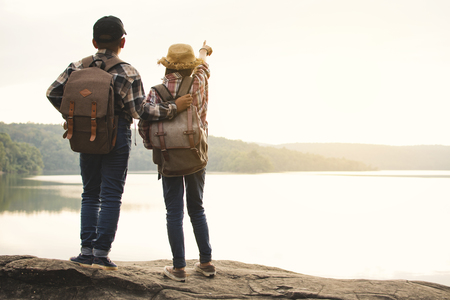 Asian girl and boy backpack in nature , Relax time on holiday concept travel,selective and soft focus,tone of hipster style Reklamní fotografie
