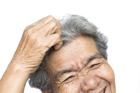 Old woman felt a lot of anxiety about hair loss and itching dandruff issue on white background, scalp problem concept Reklamní fotografie