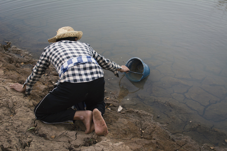 Asian man on nature ,crisis of water drought concept, selective and soft focus Zdjęcie Seryjne - 94542122