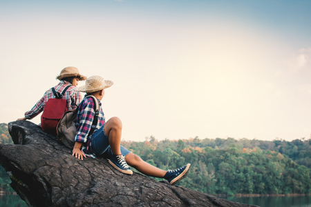 Asian girl and boy backpack in nature , Relax time on holiday concept travel,selective and soft focus,tone of hipster style Stock Photo