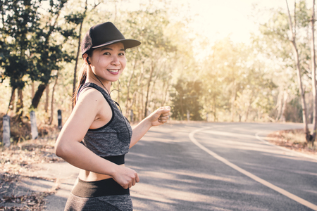 Woman running on the road for health, color of vintage tone selective and soft focus Stock Photo