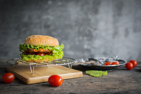 Hamburger pork meat with fresh vegetable and tomato on wood table
