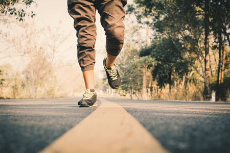 Man running on the road for health, color of vintage tone selective and soft focus