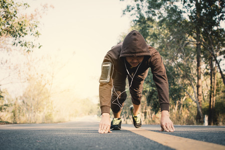 Man doing exercise on the road for health, color of vintage tone selective and soft focus
