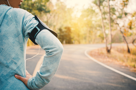 Woman doing exercise and rest on road, color of hipster tone selective and soft focus Foto de archivo