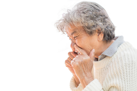 Old woman cough on white background. Illness of the elderly problem concept Foto de archivo