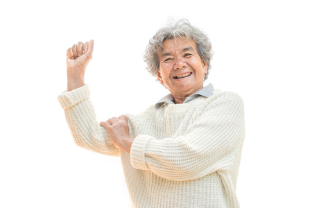 Happy Asian old woman smiling and joyful on white background