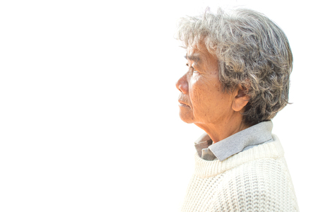 Side view of an old woman on white background. Foto de archivo