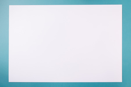 Empty white paper on blue background
