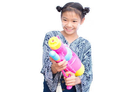 Cute girl playing water gun on white background, Songkran Festival in Thailand and summer season Reklamní fotografie